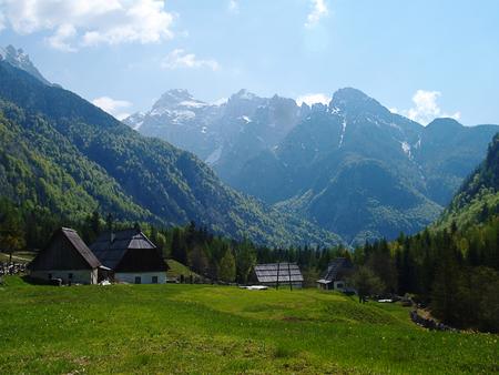 farmhouses: Traditional Alpine farmhouses in the mountains Stock Photo
