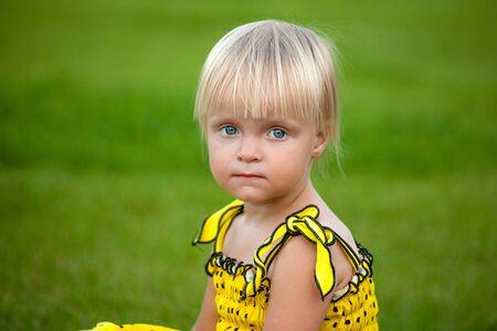 Beautiful blonde girl outside