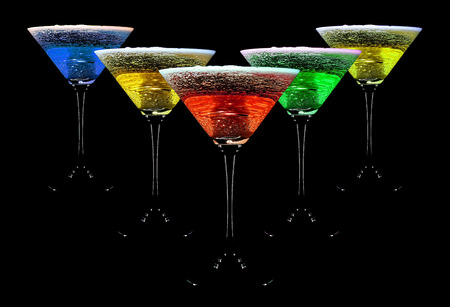alcohol water crown in cocktail glasses, black background Stock Photo