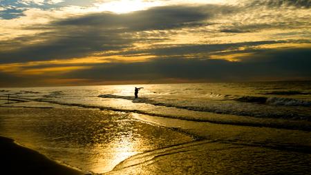 Sunrise at the shore line,Hilton Head Island SC ,surf fisherman.