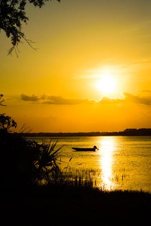 Small fishing boat at anchor,sunset near shore Hilton H  ead Island SC, ICW.