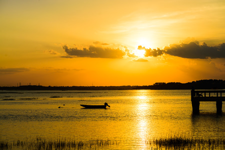 Small fishing boat at anchor at sunset,Hilton Head Island SC.
