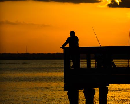 Silhouette of fisherman on pier,Intercoastel Waterway. at Hilton Head Island SC