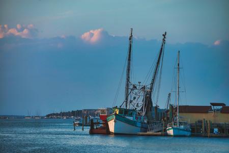 Shrimp boat at the dock ,sunset on Hilton Head Island SC. Stock Photo