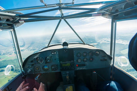 Point of view from cockpit of small sport plane. Фото со стока