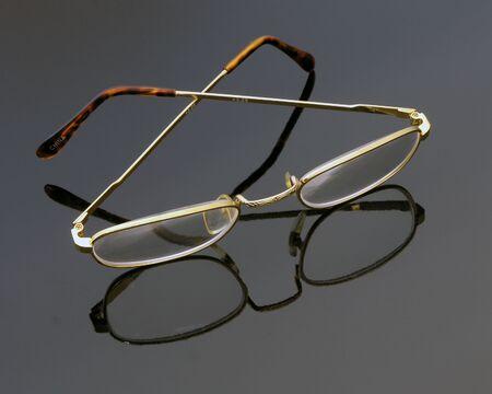 Eye glasses on glass