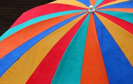 Rainbow colored beach umbrella