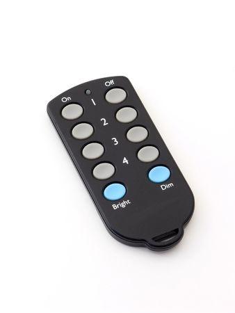 Mini key chain remote control over white.
