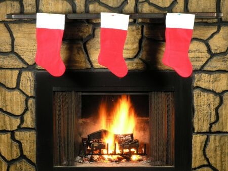 stone fireplace: Red christmas stockings hung by a lit fireplace