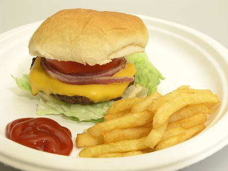 catsup: Cheeseburger,french fries and ketchup on a paper plate Stock Photo