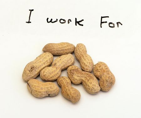 Peanuts with I work for written on photo Banco de Imagens
