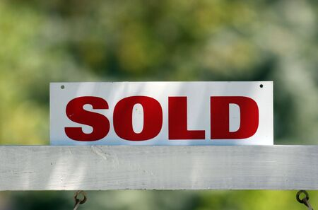 Real estate red and white sold sign