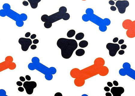 Colorful dog bone shapes and paw prints isolated over white. Stock Photo