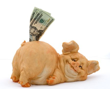 Smiling porcelain pig piggy bank with 20 dollar bills over white