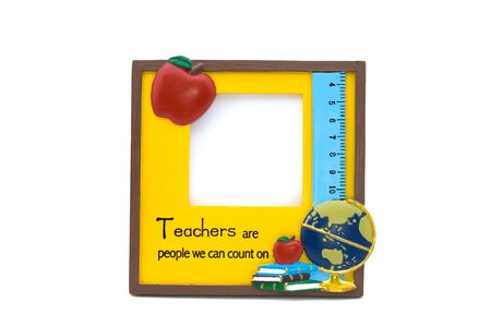 A yellow teachers photo frame with apple,  and books