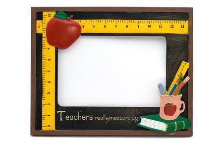A teachers photo frame with apple, ,pencils and books  Reklamní fotografie