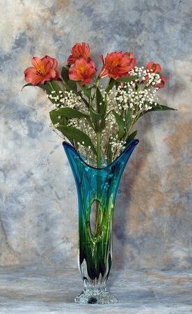alstromeria: Alstromerias in a glass vase against a soft colorful canvas background Stock Photo