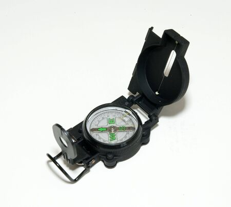 Sophisticated black hand held compass over white