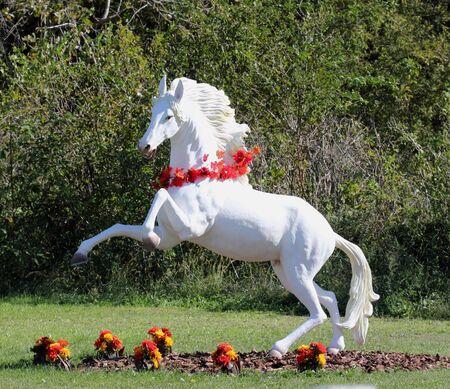 rearing: Beautiful life size white horse garden figure