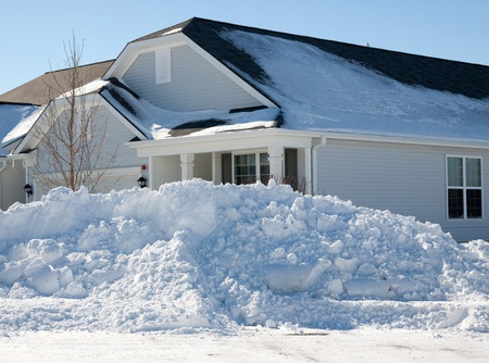 corner house: View of corner house with large plowed pile of snow after February blizzard of 2011 Stock Photo