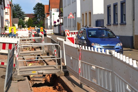 redirection: Construction site with blue car