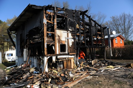 Police observes destroyed home Editorial