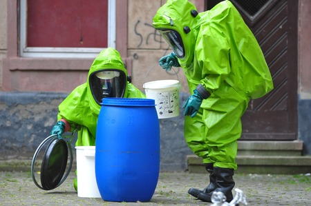radiation protection suit: Chemical experts exploring site at school after accident