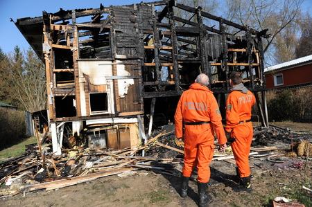 observes: Police observes destroyed home Stock Photo