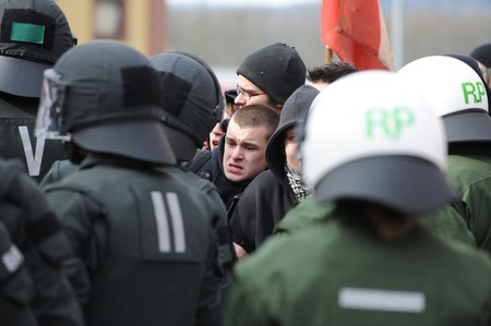 nazis: Zweibruecken, Germany - March 20, 2009: Protests against Neo Nazis and right wing extremists. Police guards counter-demonstrators Editorial