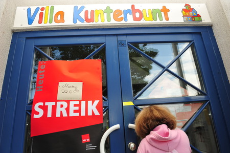 ugt: Worms, Germany - June 22, 2009 - Girl waiting in front of closed kindergarten