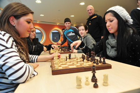 Worms, Germany - December 2, 2010 - Pupils playing chess as a school project to improve teamwork and socialisation