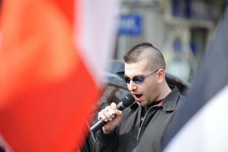 disobedience: Zweibruecken, Germany - March 20, 2009: Protests against Neo Nazis and right wing extremists demonstrating. Right wing speaker during demonstration. Editorial