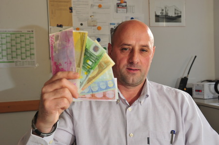 forger: Frankfurt, Germany - December 14, 2010: Police office showing and investigating counterfeit money, Euro, which has become a problem in Germany and Europe Editorial
