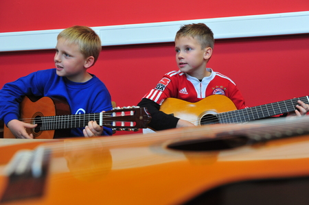 baby boy: Mainz, Germany - November 17, 2011: Musical education in german primary school as a important part of education and integration Editorial