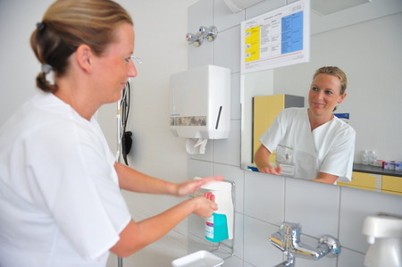 hygenic: Frankfurt, Germany - September 17, 2009 - Doctor washing hands in hospital to avoid infections