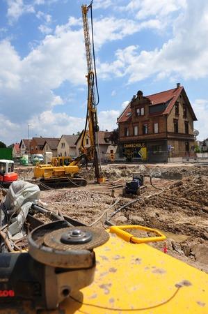 redirection: Frankfurt, Germany - June 25, 2009 - Railway underpass construction site with yellow machines
