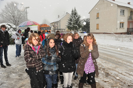 worse: Frankfurt, Germany - December 20, 2010: Pupils rely on public transport in winter, which gets worse while communities lacking money