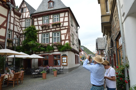 hesse: Bacharach, Germany - August 23, 2015: Tourists walking through old streets in Bacharch at river rhine