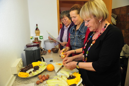 Worms, Germany - September 9, 2015 - Women from rotary club cooking together for refugees Editorial
