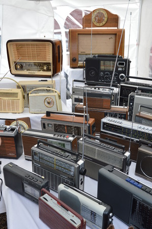 untidiness: Cologne, Germany - September 6, 2015 - Old radio devices on garage market as a source for cheap shopping and collectors