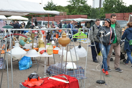 untidiness: Cologne, Germany - September 6, 2015 - Old lamps and visitors on garage market, a source for cheap shopping and collectors Editorial