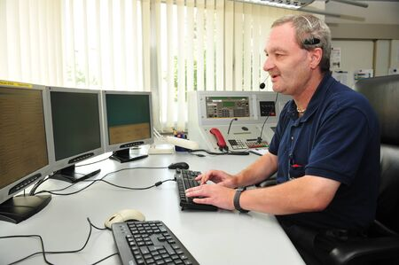 Worms, Germany - Jule 21, 2009 - Fire fighter in control room of fire department Worms taking an emergency call