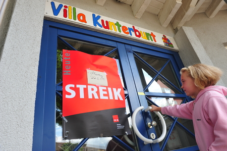 ugt: Worms, Germany - June 22, 2009 - Women protest against low payment in the nusery and kindergarten segment, strike and demonstrations
