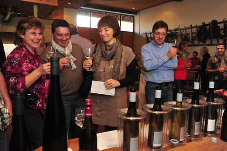 Worms, Germany - November 1, 2010 - People tasting wine and winemaker serving