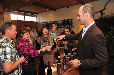 winemaker: Worms, Germany - November 1, 2010 - People tasting wine and winemaker serving
