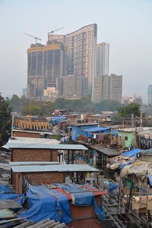 Mumbai, India - October 19, 2015 - Muslim washing spot Dhobi Ghat in front of Mumbai skyline