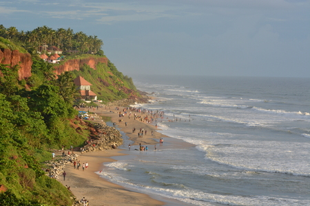 varkala: Varkala, India - November 2, 2015 - Pilgrims on Varkala beach, a holy place for hindus Editorial