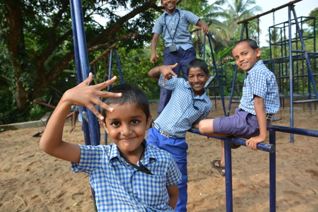 childrens playing: Mumbai, India - October 28, 2015 - Children from children�s home playing on playground powered by charity project based in Europe