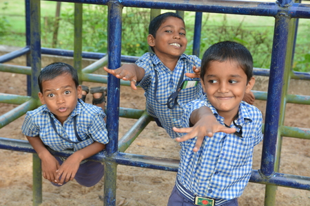Mumbai, India - October 28, 2015 - Children from children«s home playing on playground powered by charity project based in Europe