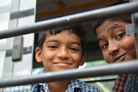 Mumbai, India - October 28, 2015 - Children from children«s home driving in school bus powered by chartiy project based in Europe